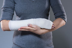 Woman support her hand in bandage Royalty Free Stock Images