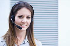 Woman support with telephone headset. Office woman it support with headset phone Royalty Free Stock Image