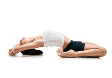Woman in supta virasana yoga position Stock Photo