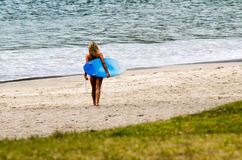 Woman with surfboard Stock Image