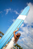 Woman with surfboard Stock Images