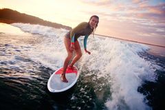 Woman on surfboard Royalty Free Stock Images