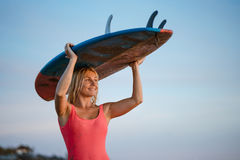Woman with a surfboard Royalty Free Stock Images