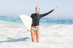 Woman with surfboard standing in sea Stock Photography