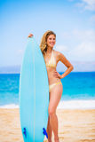 Woman with Surfboard at thte Beach Royalty Free Stock Photo