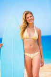 Woman with Surfboard at thte Beach Stock Photo