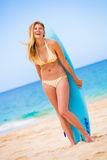 Woman with Surfboard at thte Beach Royalty Free Stock Photography