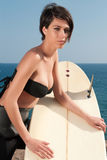 Woman with surfboard under blue sky Stock Photos