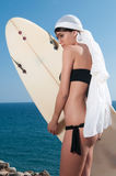 Woman with surfboard waiting for waves Royalty Free Stock Photos
