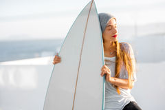 Woman with surfboard on the white city background Stock Photography