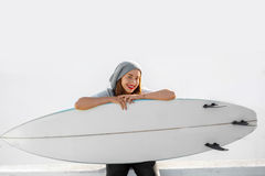 Woman with surfboard on the white city background Royalty Free Stock Photography