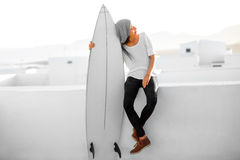 Woman with surfboard on the white city background Royalty Free Stock Photo