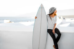 Woman with surfboard on the white city background Stock Image