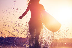 Woman with surfboard royalty free stock photography