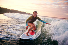Woman surfboarding Royalty Free Stock Photos