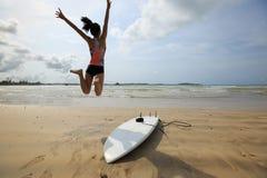 Woman surfer jumping stock photos