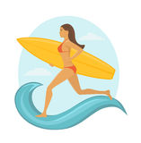 Woman surfer running with surfboard to catch the wave. Royalty Free Stock Photography