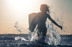 Woman surfer stock photography