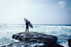 Woman surfer with surfboard royalty free stock photography