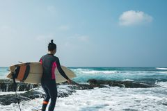 Surfer woman with surfboard royalty free stock image