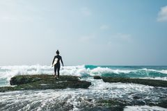 Woman surfer with surfboard stock photography