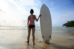 Woman surfer with white surfboard Stock Image