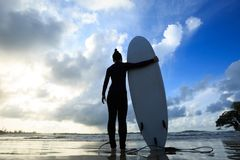 Woman surfer with white surfboard  Royalty Free Stock Images