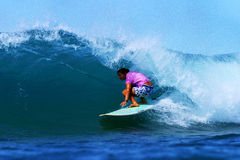 Woman Surfing Champion Joy Monahan. Pro surfing champion, Joy Monahan surfing on a longboard in Waikiki on the island of Oahu, Hawaii Stock Image