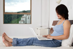 Woman surfing internet Royalty Free Stock Photography