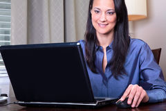 Woman surfing the internet Royalty Free Stock Photo
