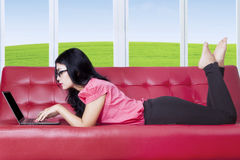 Woman surfing on internet at home Royalty Free Stock Image