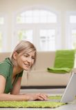 Woman surfing the internet at home Stock Photography