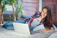 Woman surfing the net at home Stock Photo