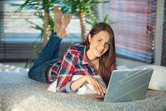 Woman surfing the net at home Stock Image
