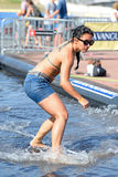 A woman surfing in a pool at LKXA Extreme Sports Barcelona Games. BARCELONA - JUN 29: A woman surfing in a pool at LKXA Extreme Sports Barcelona Games on June 29 stock photos