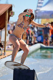 A woman surfing in a pool at LKXA Extreme Sports Royalty Free Stock Photo
