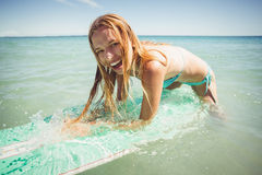 Woman surfing in sea Stock Images