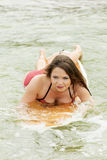 Woman surfing in sea Stock Photography