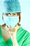 Woman surgeon holding her chin Stock Photo
