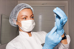 Woman surgeon preparing her injection Stock Image