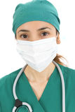 Woman surgeon with a surgical mask Royalty Free Stock Photography