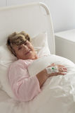Woman after surgery Stock Photo