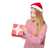 Woman surprise with opening red gift box Royalty Free Stock Photo