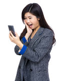 Woman surprise with text message Royalty Free Stock Photos