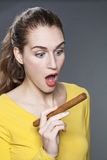 Woman surprised with cigar Royalty Free Stock Image