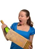Woman is surprised and enjoys receiving a gift of expensive champagne Royalty Free Stock Image