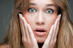Woman with surprised expression Royalty Free Stock Images