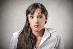 Woman with a surprised expression Royalty Free Stock Photos