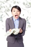 Woman surprised face with falling money Stock Photography