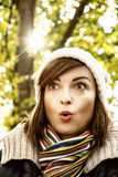 Woman with a surprised facial expression in autumn park, yellow Royalty Free Stock Photo
